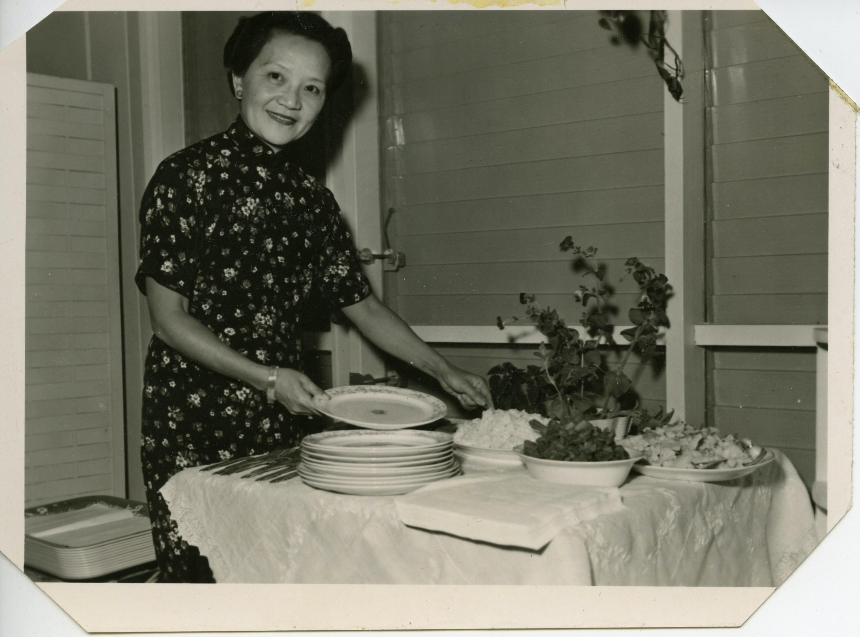 Grace Zia Chu standing by a buffet