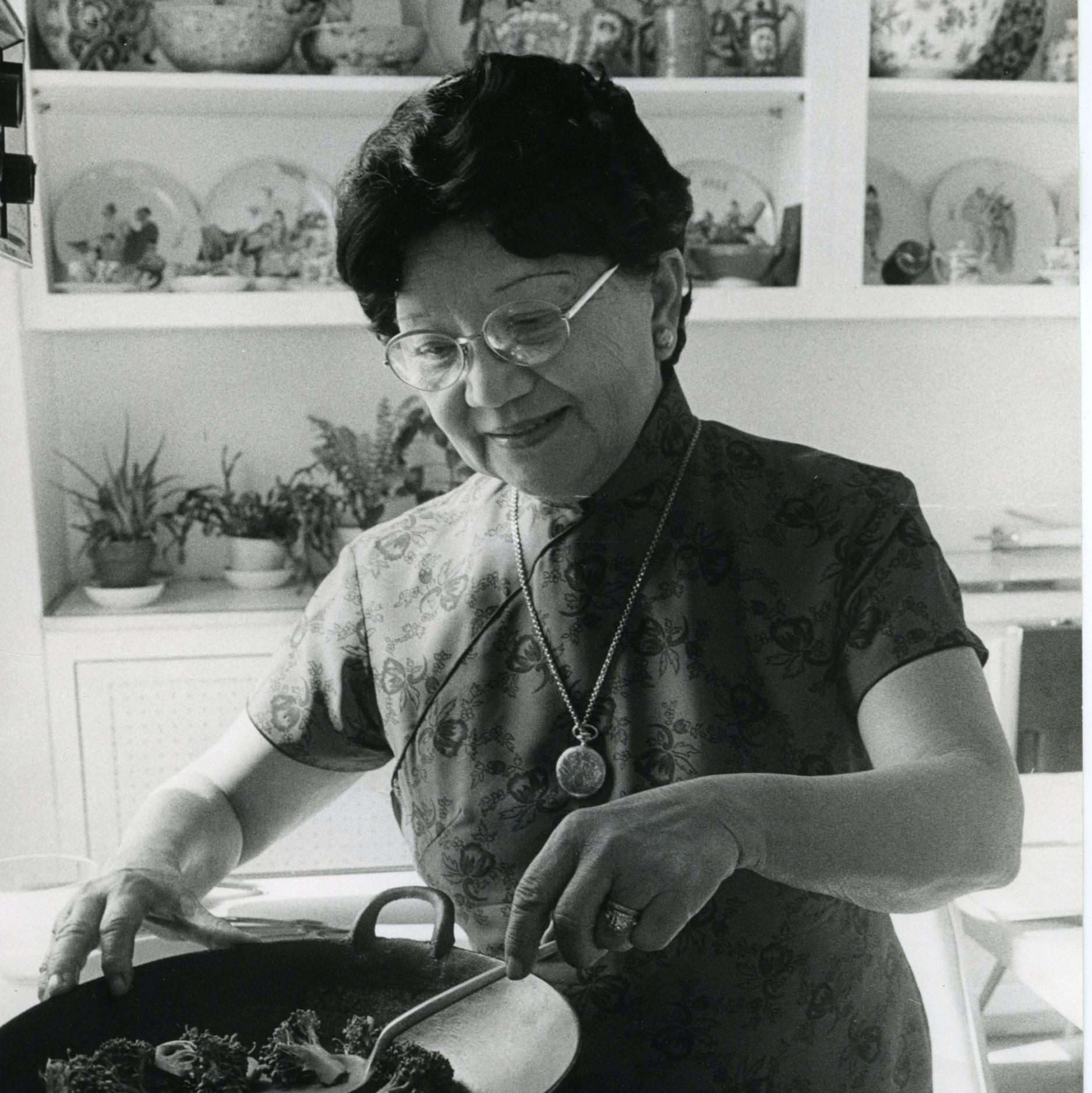 Grace Zia Chu stir frying broccoli