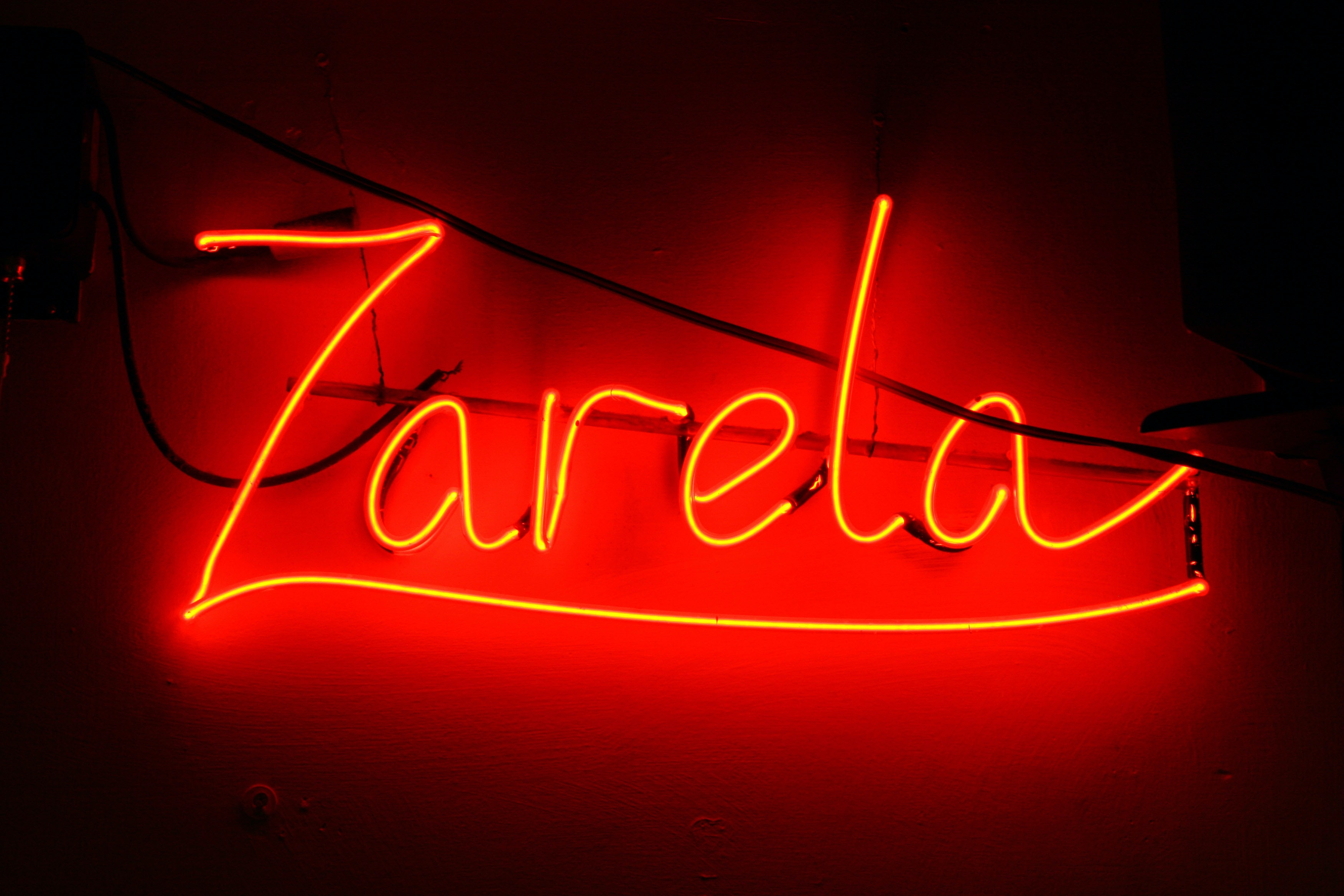 "Neon sign in red, ""Zarela"""