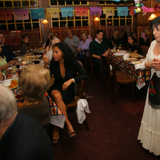 Zarela speaks to a crowd at a private party at restaurant
