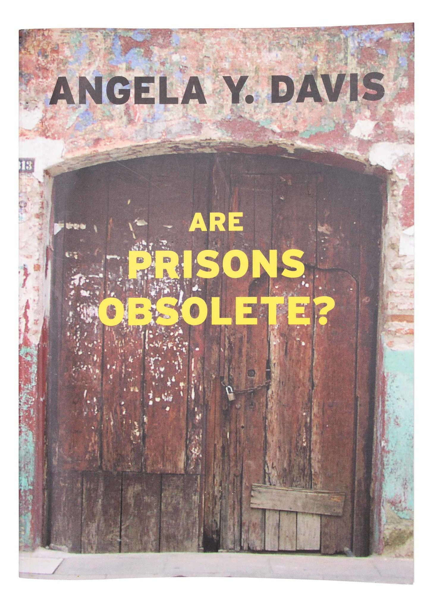 """Book cover with two large wood doors. Text reads """"Are Prisons Obsolete?"""" in yellow font."""
