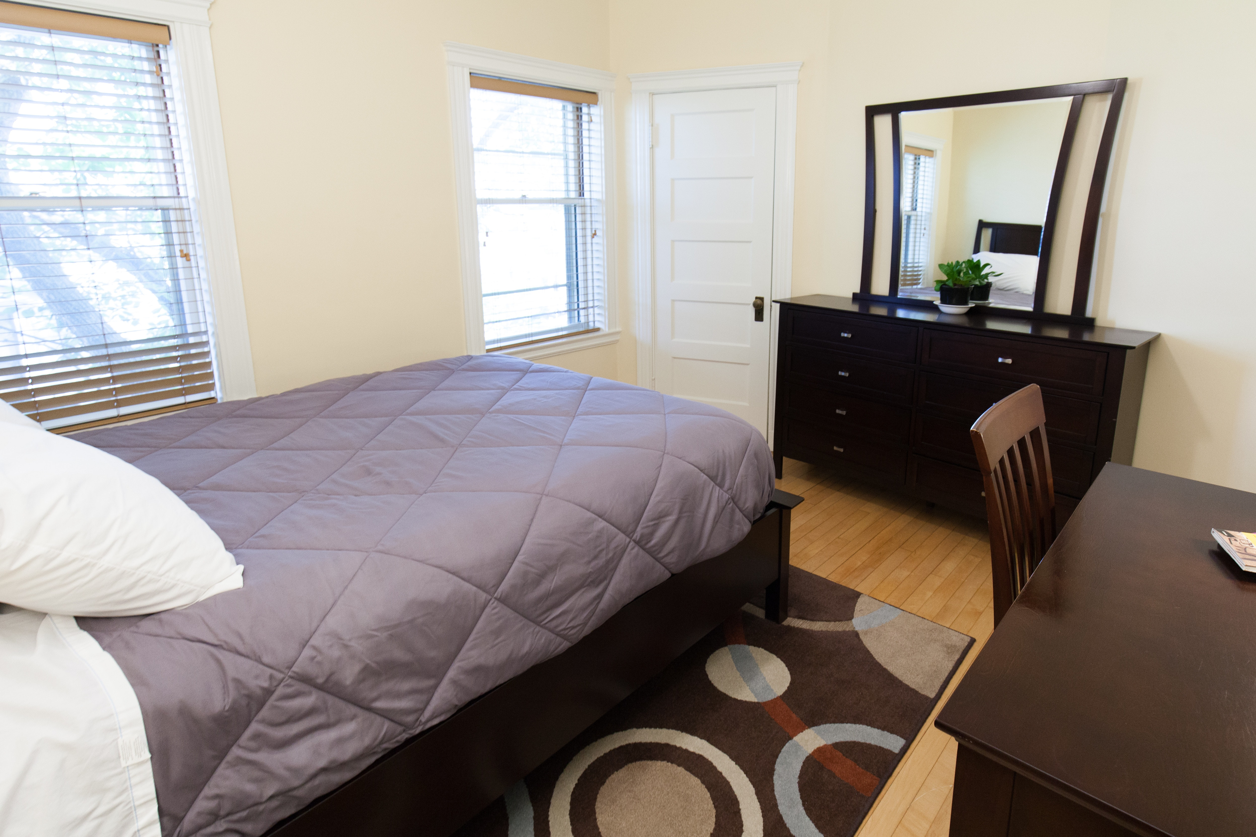 Bedroom with furnishings in 83 Brattle Street one bedroom apartment