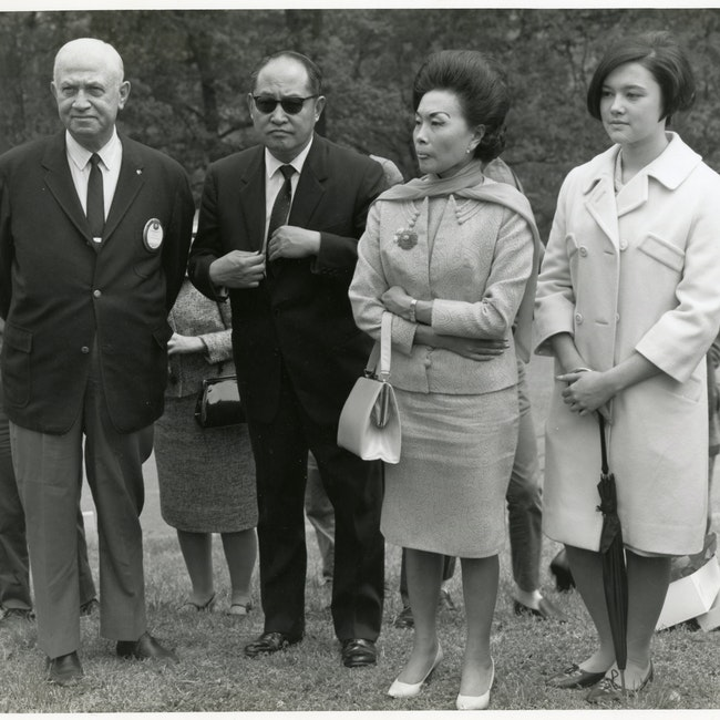 Anna Chennault with her daughter and others at a ceremony at Arlington National Cemetery