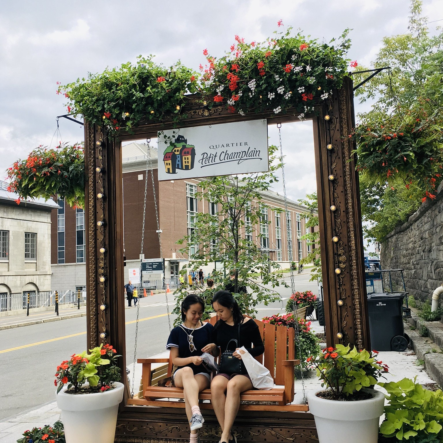 Vanessa Hu and sister sitting on a bench in Quebec City, Montreal