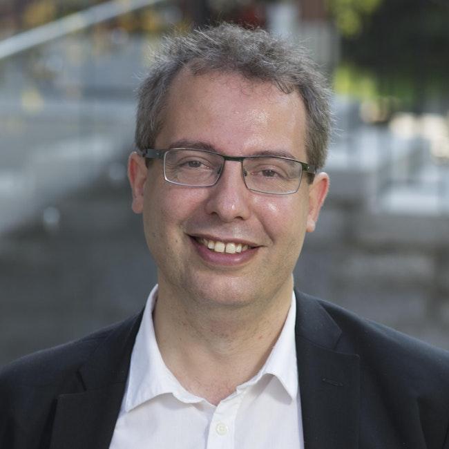 Headshot of Dániel Péter Biró