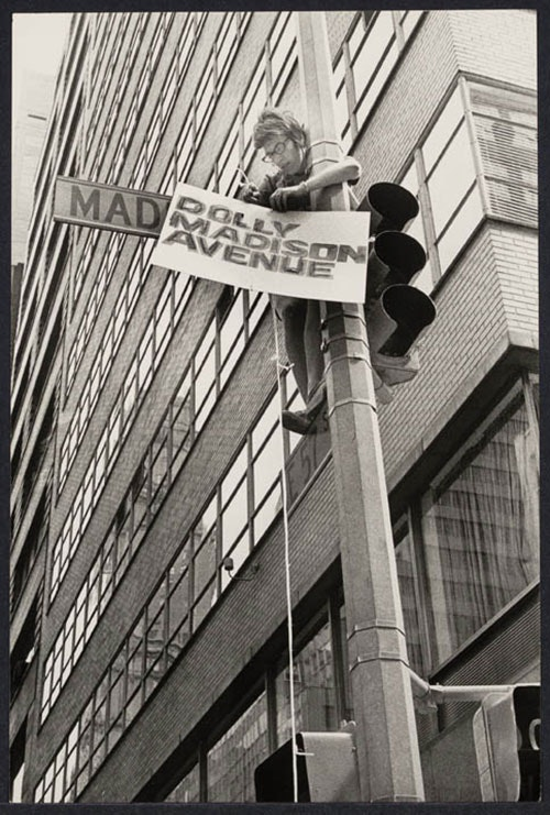 Woman putting up Dolly Madison sign, August 26, 1971