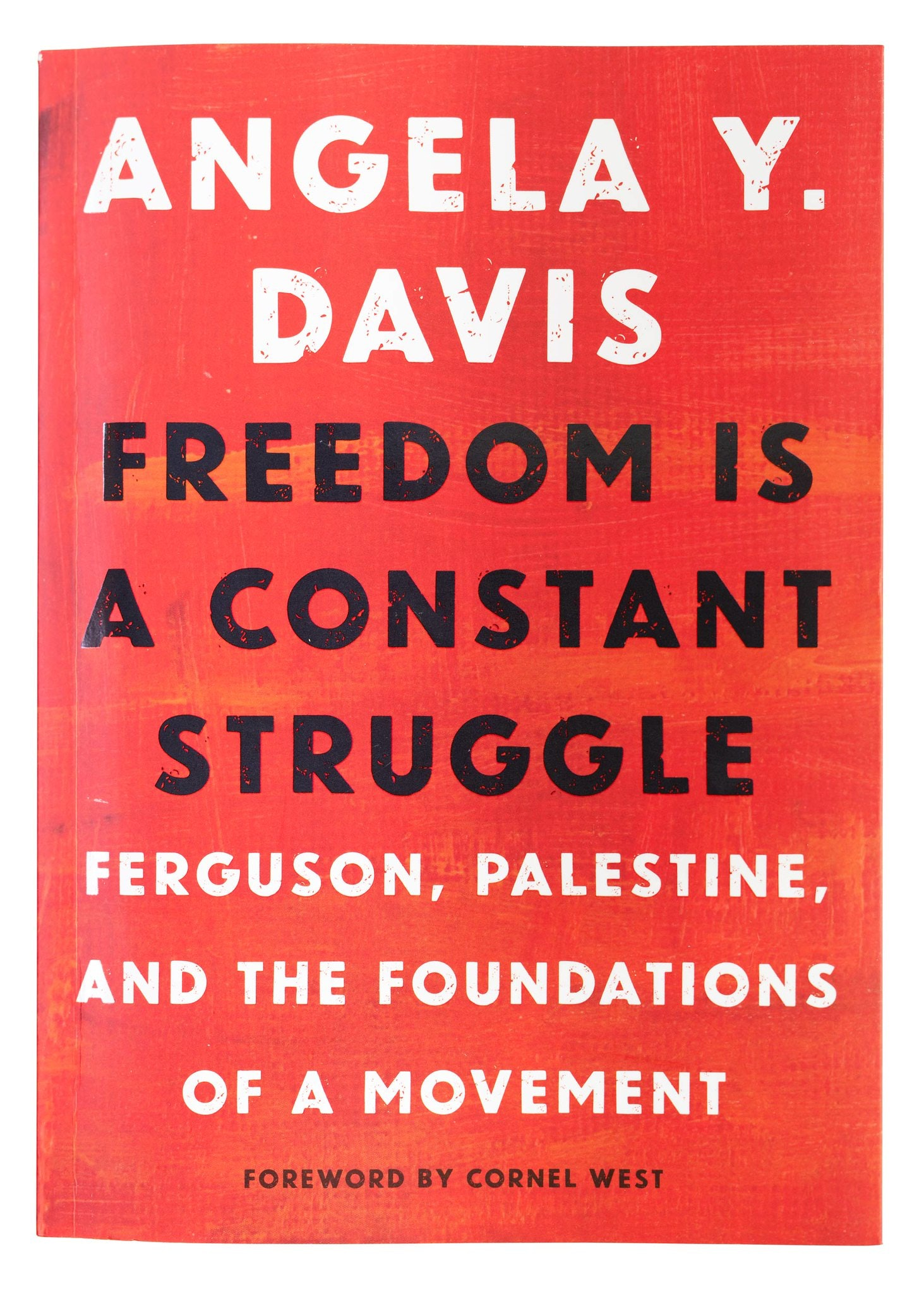 """Red book cover for Angela Davis' """"Freedom is a Constant Struggle."""""""