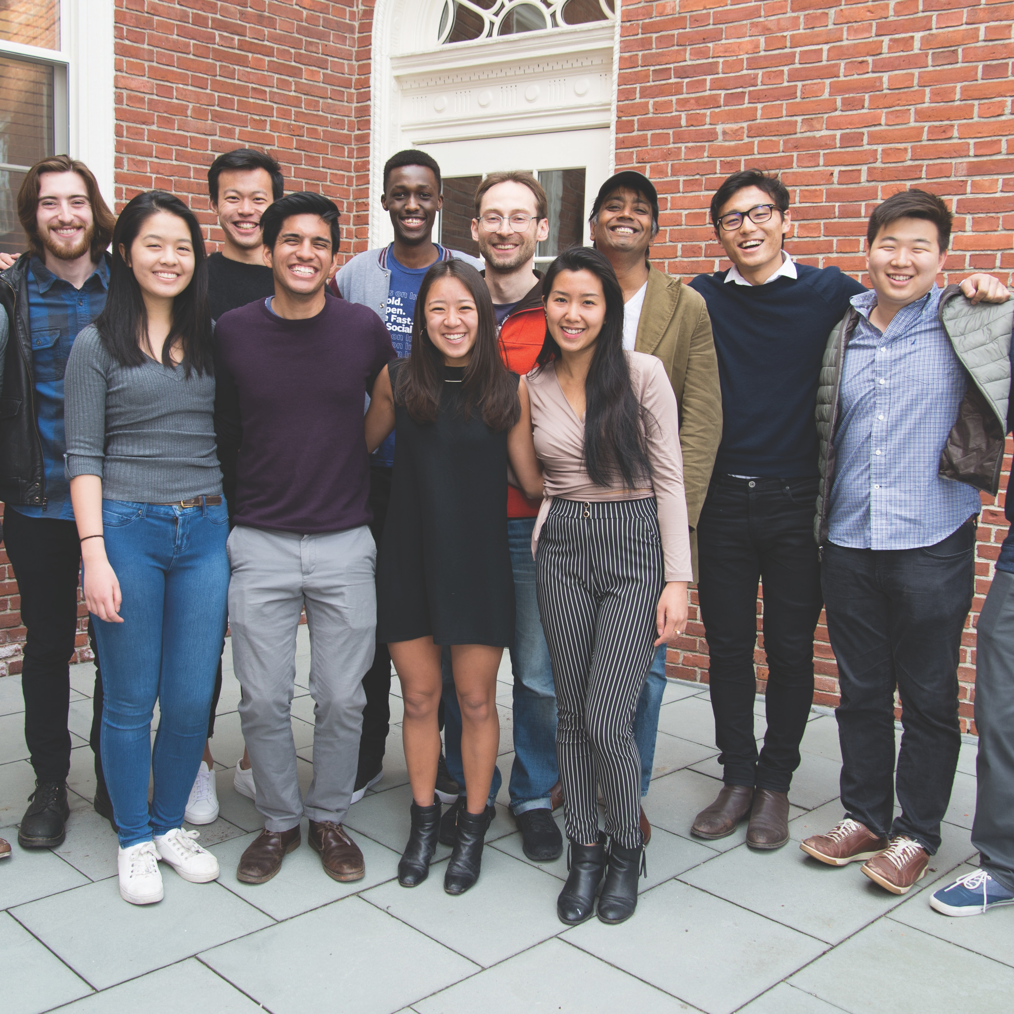 Radcliffe fellows posing in group photo with undergraduates of the Radcliffe Research Partnership program