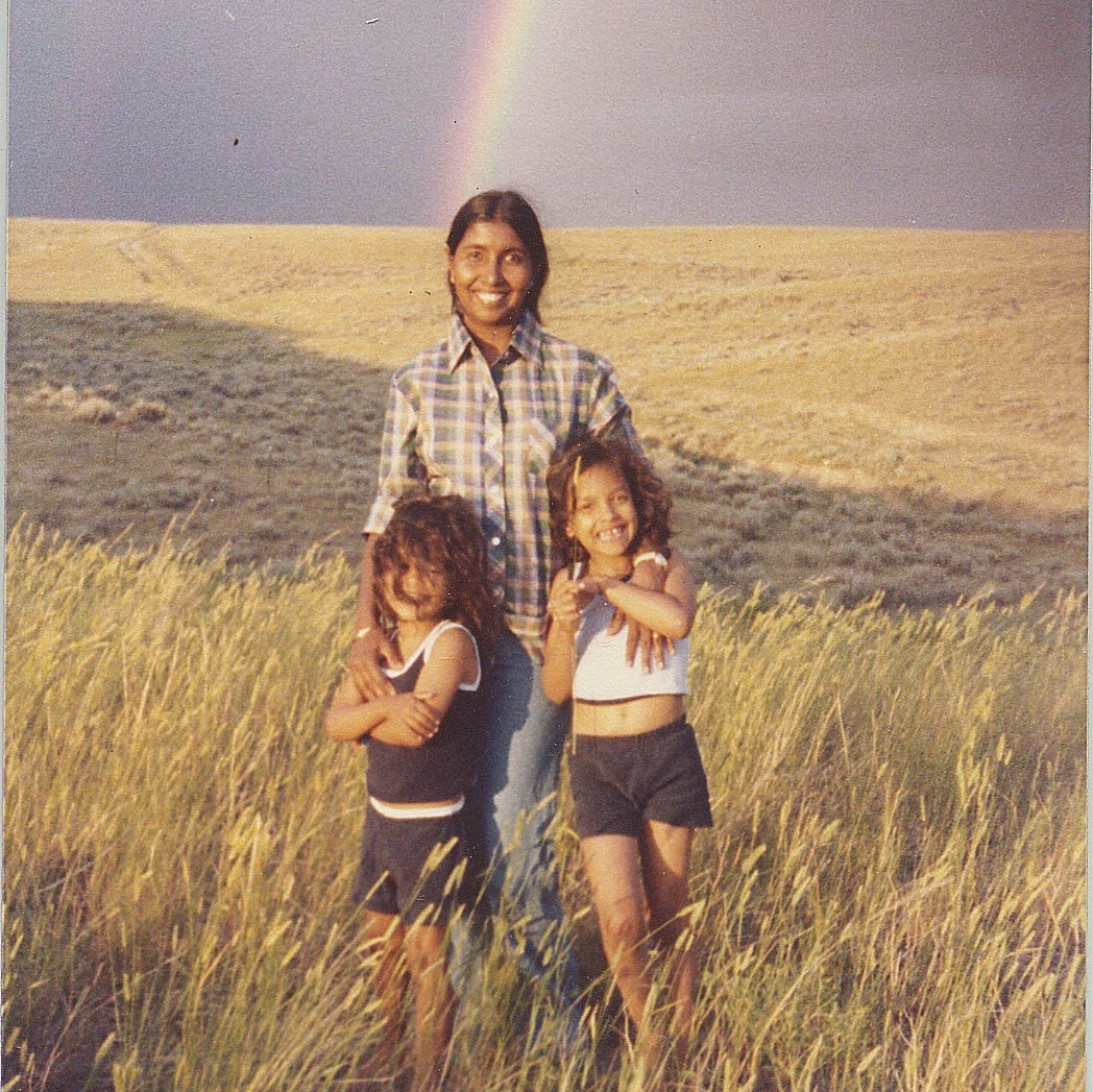 Nina McConigley with her sister when they were children, posing with their mother on the high plains of Wyoming