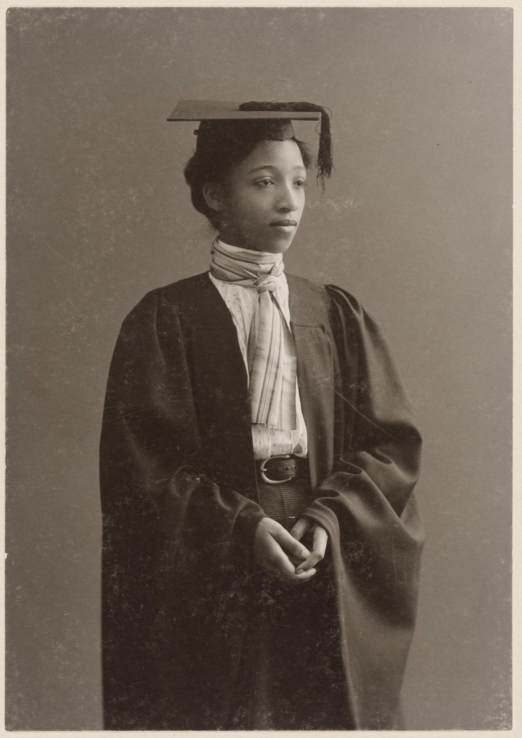 Sepia toned photograph of Alberta Virginia Scott in graduation cap & gown.