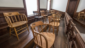 empty chairs in a jury box.