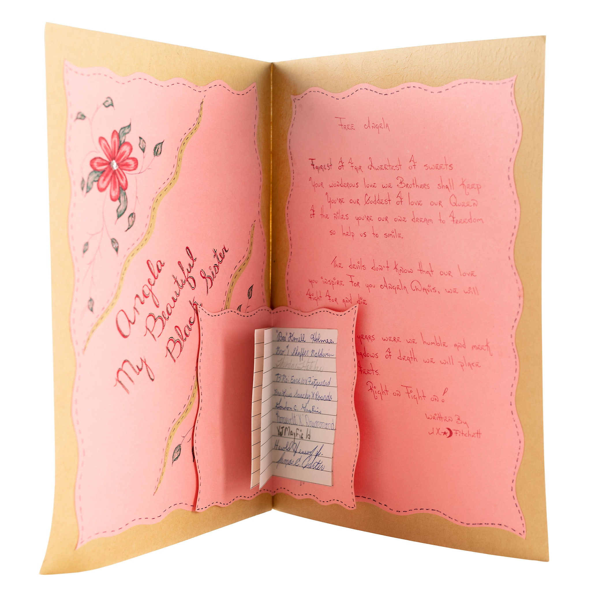 Interior booklet lined with pink paper with handwritten text.