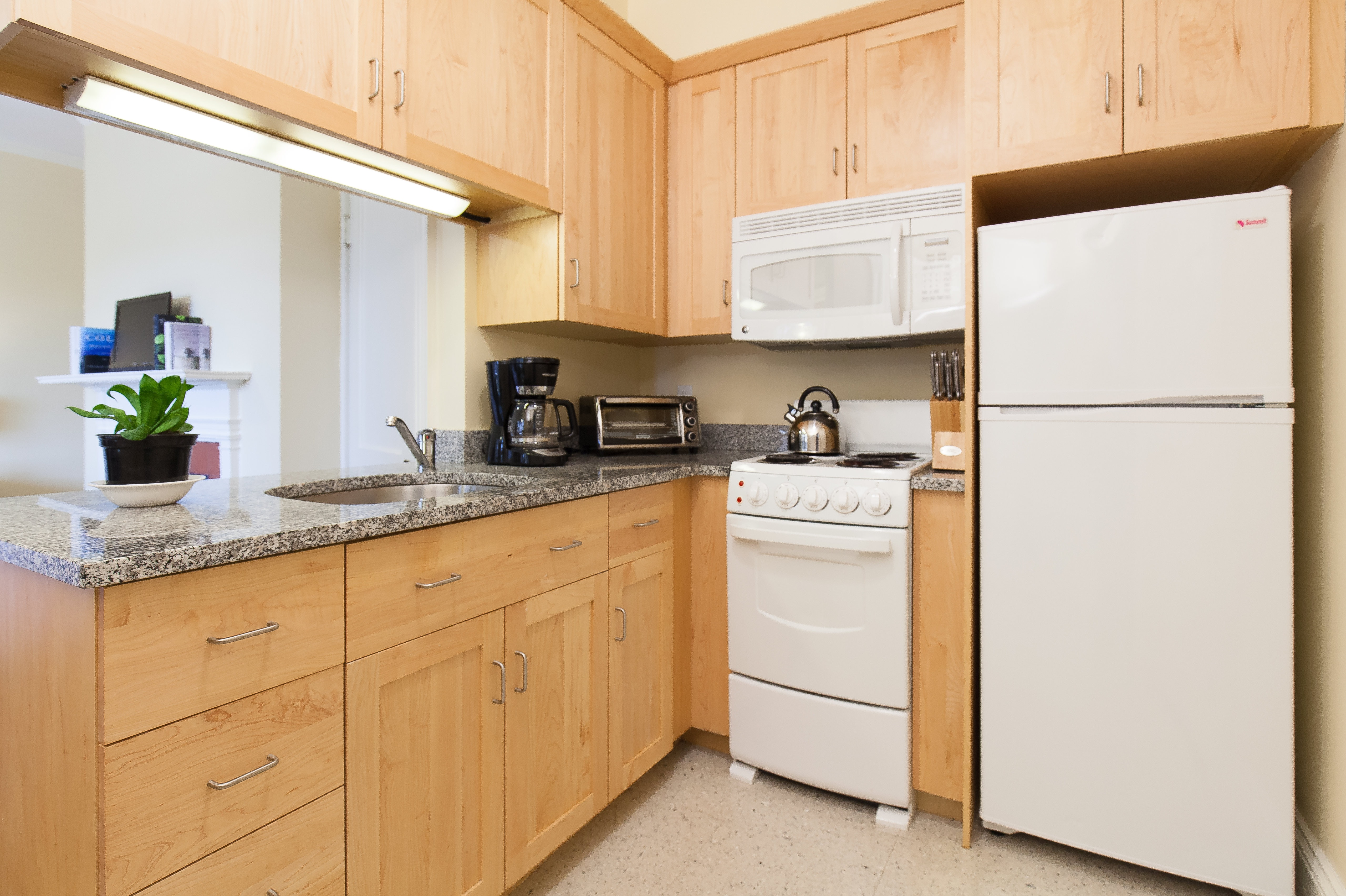 Kitchen in 83 Brattle Street studio apartment.