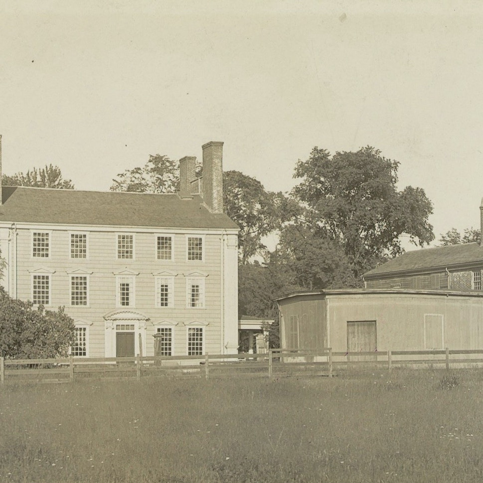 A sepia-toned photo of a mansion and slave quarters, in Medford, Massachusetts.